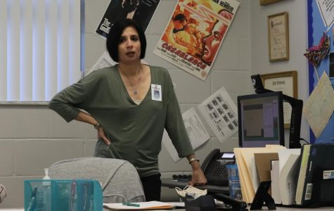 English teacher Lisa Gendreau gets frustrated with the computer problems she is having while teaching face-to-face and Connect students at the same time.