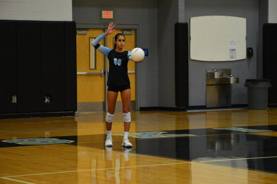 Freshman Sophia Marini sets the ball. The girls volleyball felt more confident going into their season after they defeated Lake Howell.