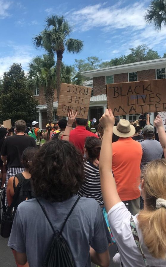 Seniors John Doe* and Sarah Rifenberg join the rest of the crowd marching down Alexandria Blvd. Students from Hagerty and Oviedo High attended.