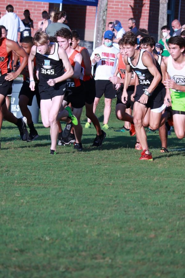 Sophomore Brayden Seymour and senior Lukas Schoenfeld lead the pack at the start of the race. Seymore finished third (17:03) and Schoenfeld finished sixth (17:20).