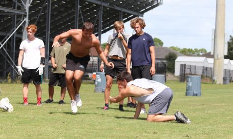 Linebacker Wyatt Wilson and ___ Alex Gorczany working on tackling drills at their Aug. 31 practice. Their first game is Sept. 17 at Timber Creek.