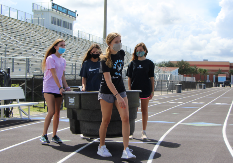 Junior Abigail Maxwell led the student athletic trainers to carry the cold-water immersion tub to the football field.