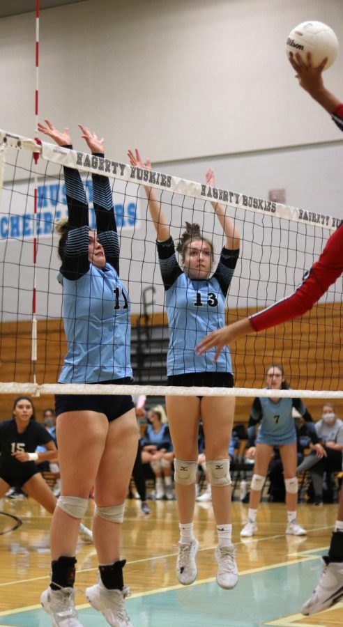 Junior Olivia Price and senior Madison Drewry go up for a block.