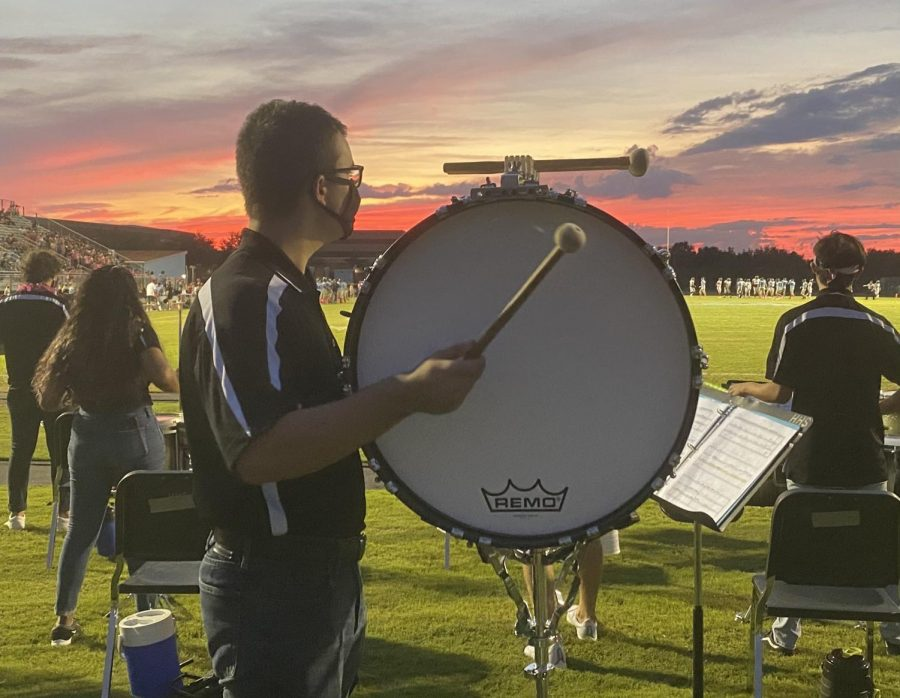 Percussionist+Matt+Hurley+plays+bass+drum+at+a+Friday+night+football+game.+Many+band+students+are+excited+to+participate+in+pep+band.