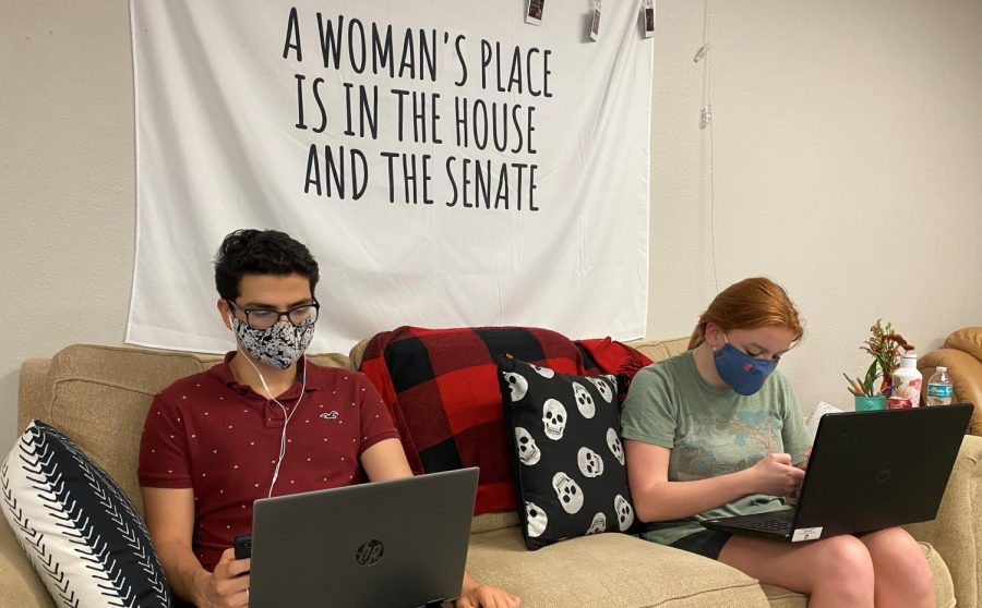 Junior Sebastian Fernandez and senior Laura Shaw phone bank on behalf of Florida Senate candidate Patricia Sigman. They called potential voters to ask if people if they had voted yet, and if not they provided advice on how to do so.