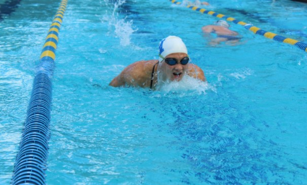 Senior Gina Dillulo warms-up for the SAC. She placed 9th in the 200 yard IM shortly after.