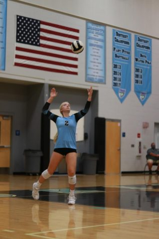 Senior Kyla Mullen is setting the ball. The team defeated Winter Park on Wednesday Oct. 28.