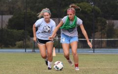 Midfielders Addison Smith and Sierra Youngblood battle for control of a ball in a drill during practice for their upcoming regular season.