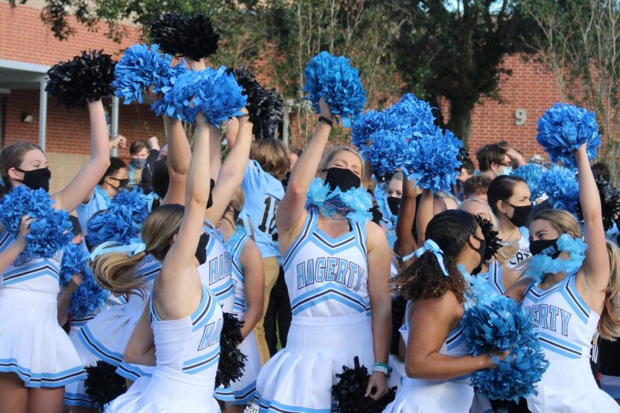 The cheerleading team performs for the Husky Huddle. They also helped plan the activity in advance.
