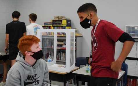 Sophomores Dylan Grossenbaugh (left) and Victor Jimenez (right) discuss an assignment in English. Masks are required and social distancing is encouraged in classrooms.