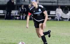 Foward Emma Canty dribbles the ball downfield versus Winter Springs.