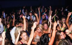 Students dance close together and enjoy their time at a homecoming dance five years ago.