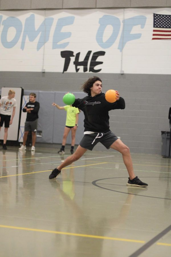 Freshman Carson Turner takes aim at the opposing team in the dodgeball tournament. Students were determined to defeat their opponents.
