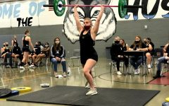 Senior Nadia Briggs performs her clean and jerk during the competition against Lake Mary.
