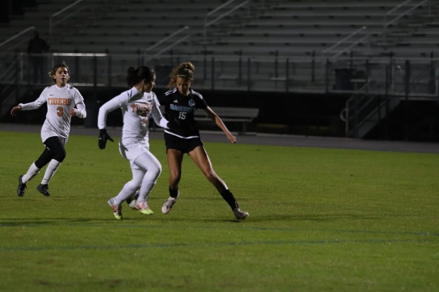 Left wing Skye Barnes dribbles around Toho defender to take a shot on goal.