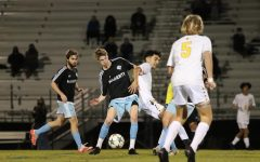 Midfielder Brayden Seymour receiving the ball in the mid field. Seymour had to keep the ball with pressure on him.