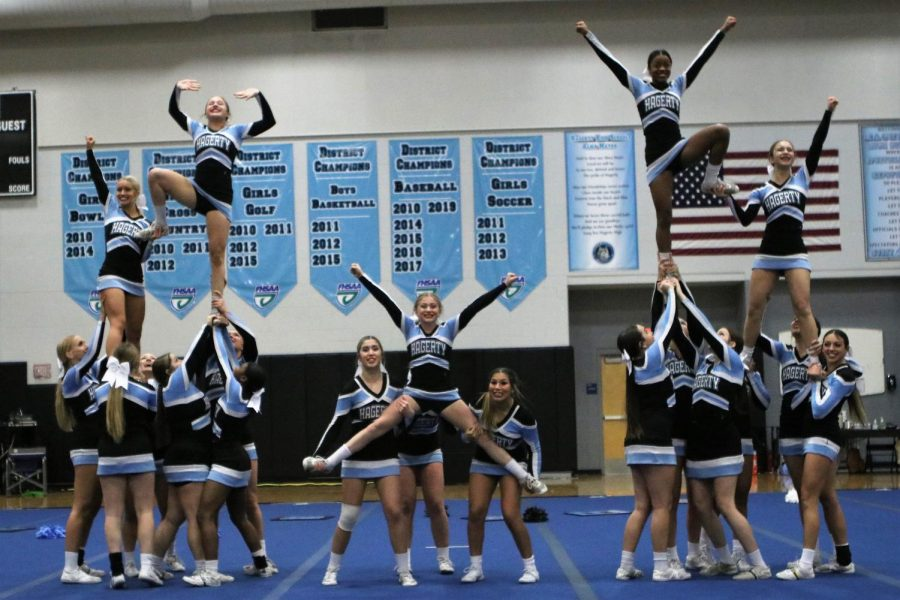 The+squad%27s+finishing+pose+at+the+end+of+their+performance+at+the+2021+Husky+Cheer+Challenge.+