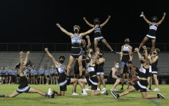 Senior cheerleaders end their final homecoming week by performing their cheer routine during the third quarter of Powderpuff.