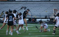 Attaacker Ellie Wilkins takes a shot on goal up the middle. She scored five goals throughout the night.