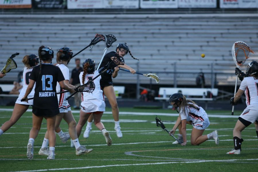 Attaacker+Ellie+Wilkins+takes+a+shot+on+goal+up+the+middle.+She+scored+five+goals+throughout+the+night.
