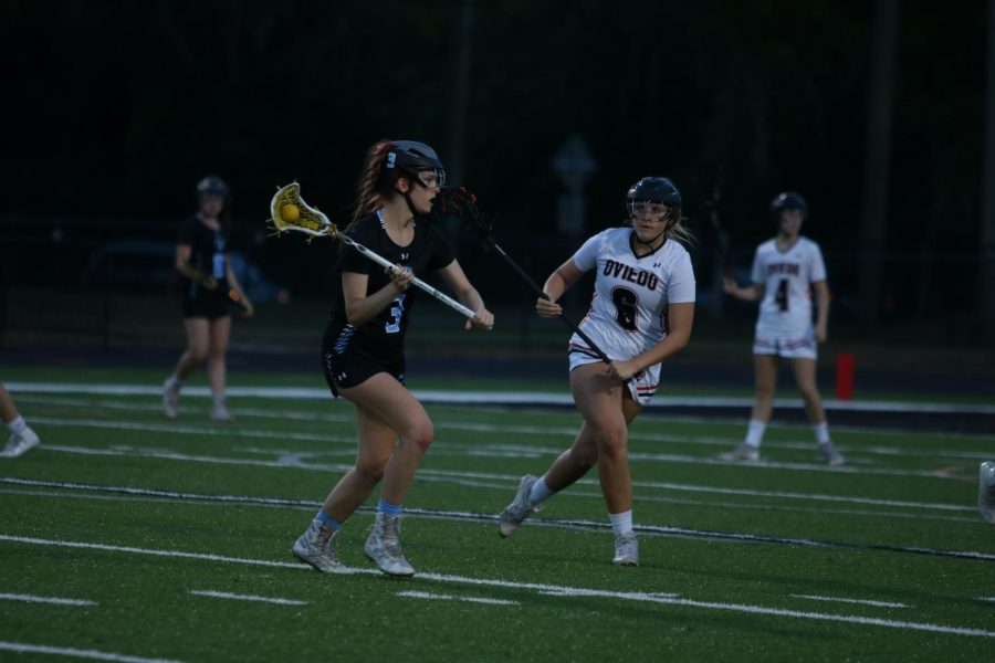 Midfielder Carly Bitner advances the ball downfield to get ready for an offensive attack.