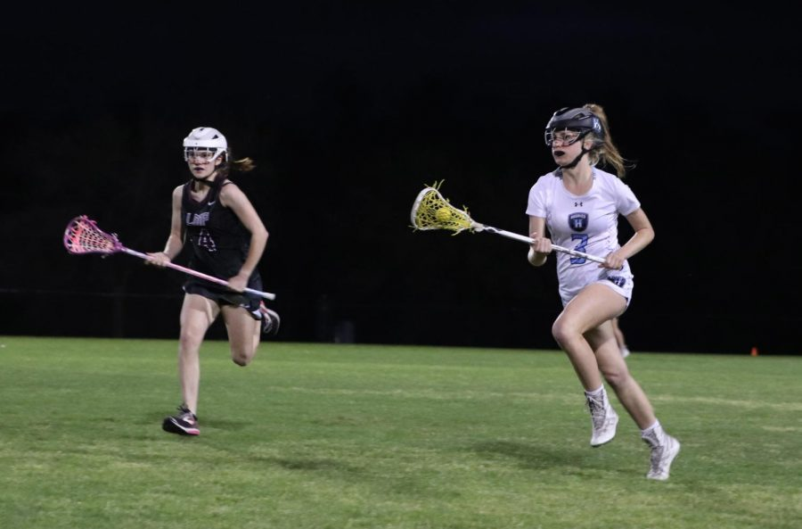 Midfielder Carly Bitner runs downfield in a senior night game against Lake Mary Prep. The team won the March 9 game 12-2.