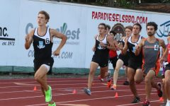 Senior Lukas Schoenfeld lead the pack at the start of the 800 meter race. Followed by junior Reagan Eastlick and senior Jacob Smith.