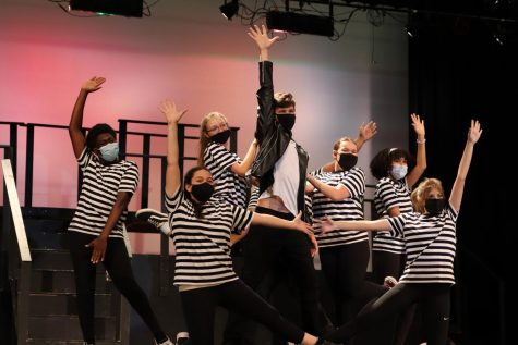 The ensemble poses around junior Jarrett Warner at the end of the first number,