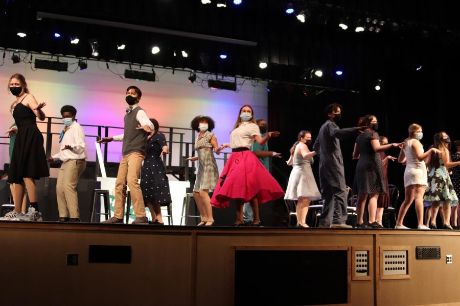 The All Shook Up cast performs the first large group number of the musical.