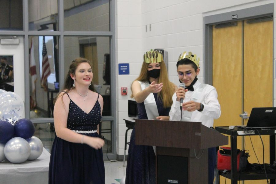 Juniors Julia Cioca and Andrew Collazo-Borges announce winners for the ROTC raffle at their banquet on April 23. Masks were worn when not presenting during the banquet.