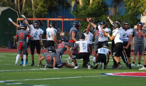 The defensive line calls a fumble recovery in the third quarter.