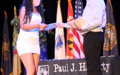 Senior Isabel Perez receives the University of Tampa scholarship. Twenty-eight others were awarded at the ceremony.