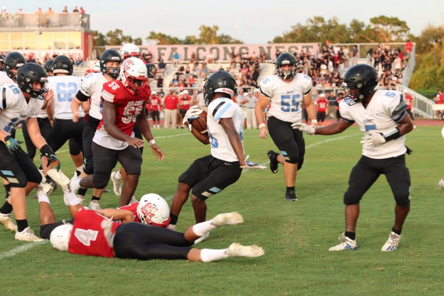 Running back Jeremiah Williams breaks a tackle. His break gained the team 15 yards.