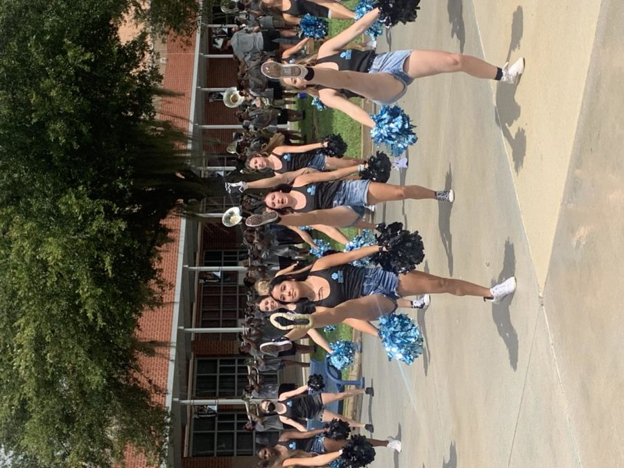 The dance team, accompanied by the varsity cheer team and marching band, preformed during both lunches last Friday to kick off the first game of the football season. Students crowded around, excited as they preformed.