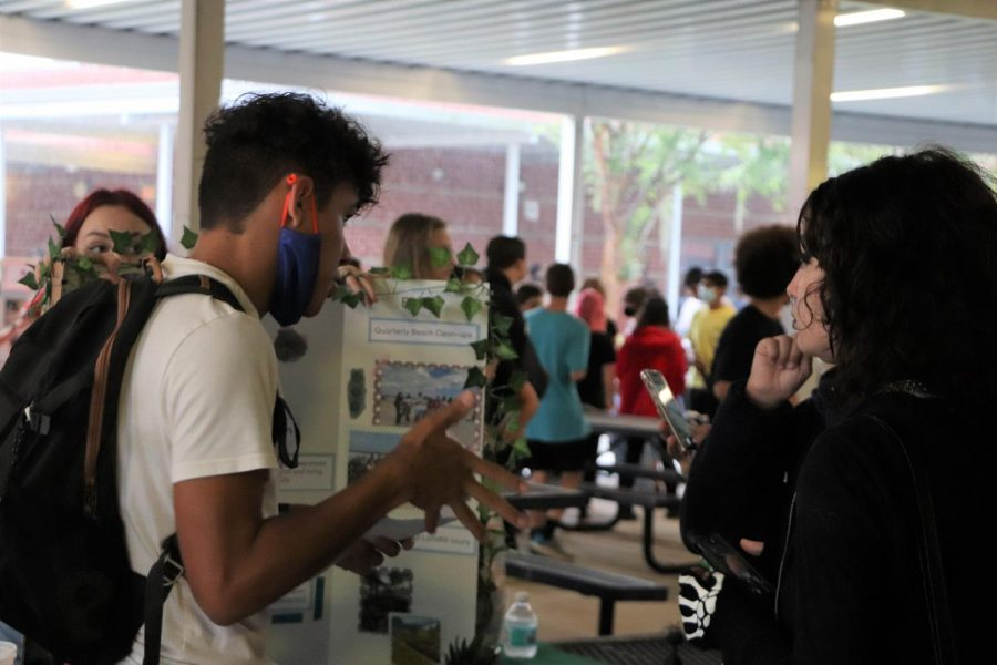 Senior Edward Collazo-Borges talks to students about the important work done by the Environmental Club. Many club leaders and members around campus talked to students about the mission statements and workloads of their organizations.