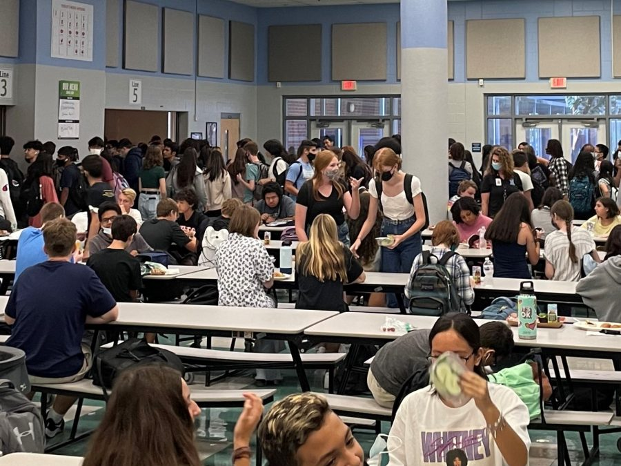 Students settle down to eat lunch on the second day of school. Many wonder how the school year will proceed.