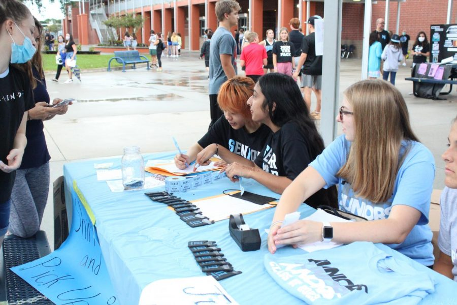 Student government officers sell class t-shirts at the Aug. 4 Club Crawl. Elections for the upcoming school year will be held on Sept. 2 and 3.