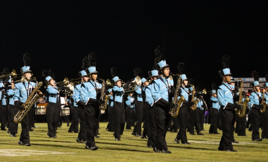 The marching band performs on the home field during the Winter Springs half time. The band returned to the home field on Sept. 10 for the first time in two years and played a compilation of Queen songs.
