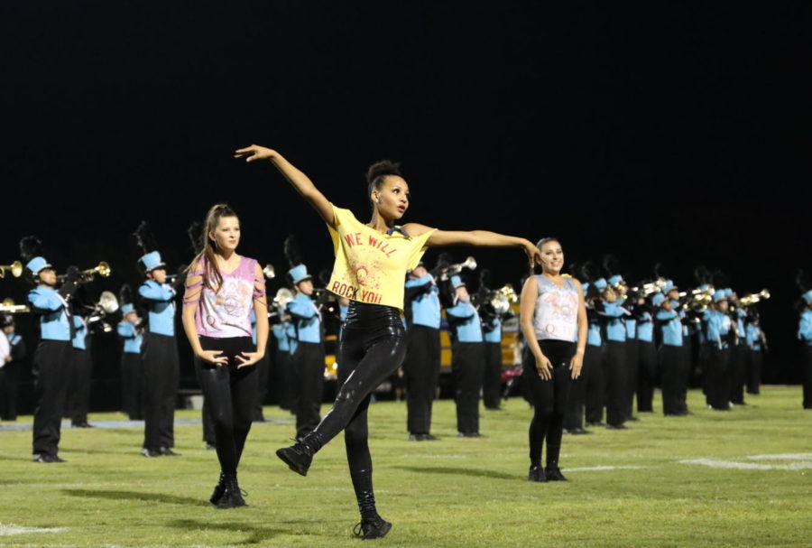 Junior Isabella Stewart dances during the Winter Springs varsity football game. The JV dance team performed with the band at half time and danced to their ballad of Queen songs.