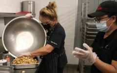 Cafeteria worker Jennifer Zoccolillo prepares hash browns. These are part of the districts breakfast for lunch.