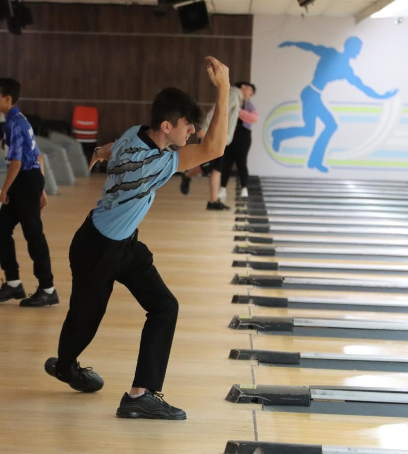 Jacob Daleandro bowls aiming to get a strike against Lake Howell. The boys varsity bowling team took first against Lake Howell.