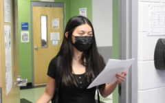 Junior Nina Honda turns in her volunteer log form to the Building 6 guidance office. After visiting Counselor Corner the previous week, Honda wasa able to get each form signed and approved by her respective counselor and learn about the Bright Futures volunteering requirments.