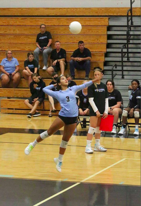 Libero Mayte Camacho is serving the ball against Winter Springs. The team  beat Winter Springs August 31, 2-3.