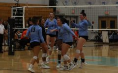 The varsity girls volleyball team celebrate after outside hitter Brooke Stephens gets the kill. The team then proceeded to win against Oviedo.