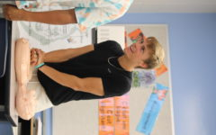 Tyler Welch performs CPR on a dummy. CPR training was part of a health training class after the PSAT this Wednesday.