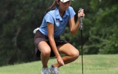 Junior Chelsea Nguyen places the ball down to get prepared for her swing.